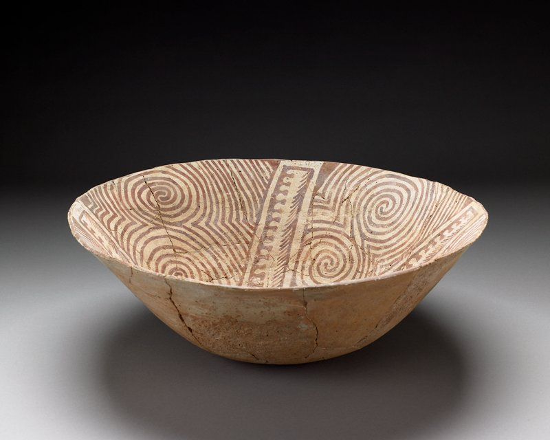 thin-walled large bowl; interior painted with spirals and other geometric designs in red