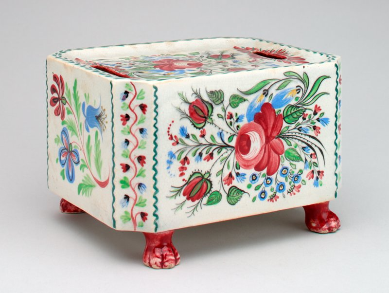 ceramic footed box with flowers painted on top and four long sides; vines on four short sides;
