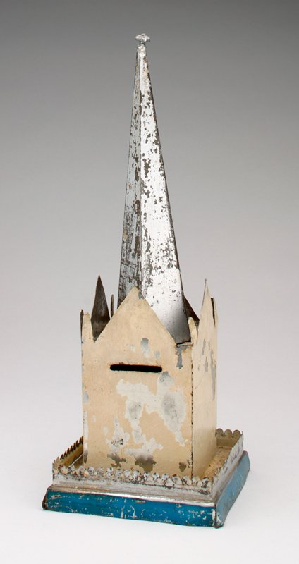 white block-shaped tower with large center triangular peak on each side and 2 smaller peaks at corners silver spire with knob on top; blue base; coin slot in side