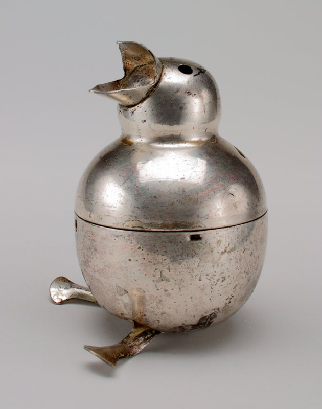 silver plated baby bird with open mouth; holes for eyes; top half unscrews; feet and legs forward