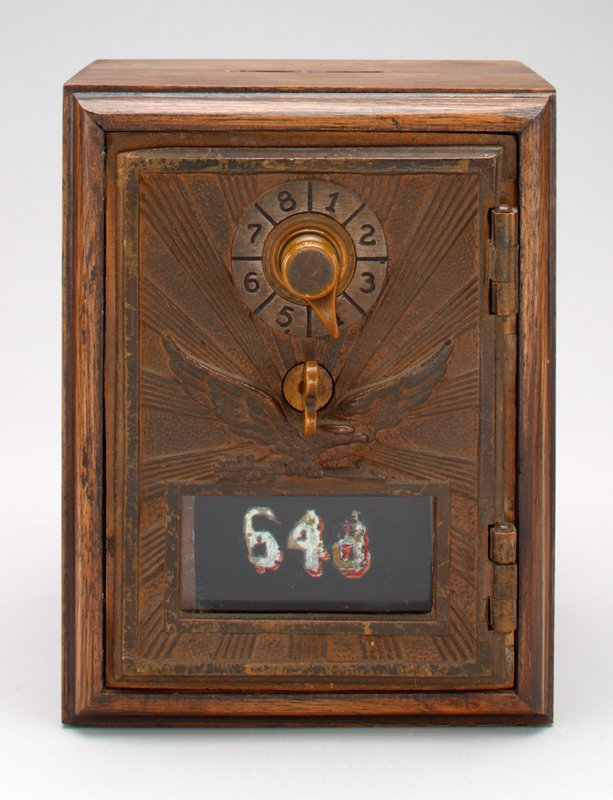 post office lock box; rectangular wood body; metal front with glass window #648; paper booklet taped to back