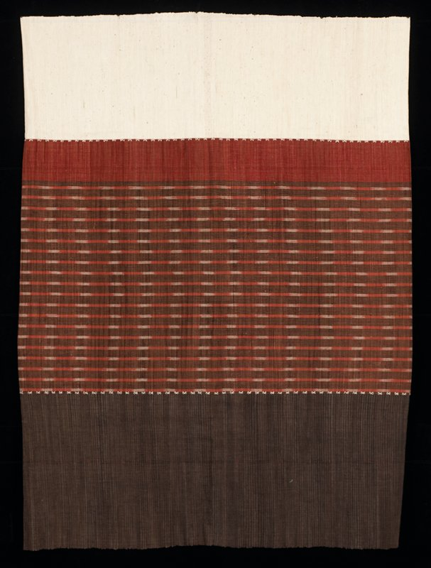 long skirt; one third of one end is white, then a red band, then a middle area of brown with horizontal red and white dashed striped, then the last third is solid dark brown to the end; white X-like stitching between color areas
