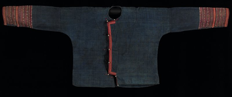 blue; extended button placket on front with appliqued red, blue and yellow stripes; embroidered linear strips and strip applique on sleeves; rectangular embroidered panel on back