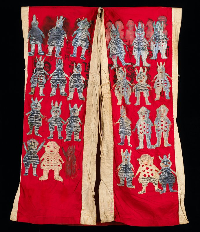 red with white trim; sleeveless; 23 appliqued human figures and one drawn human figure on front of coat; ink-drawn figures at interior chest; open sides; one green monster-like figure appliques on back of each shoulder