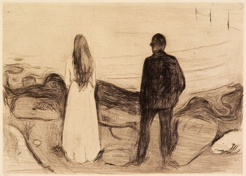 man in dark suit and woman with long hair in light dress, seen from back, looking out toward water