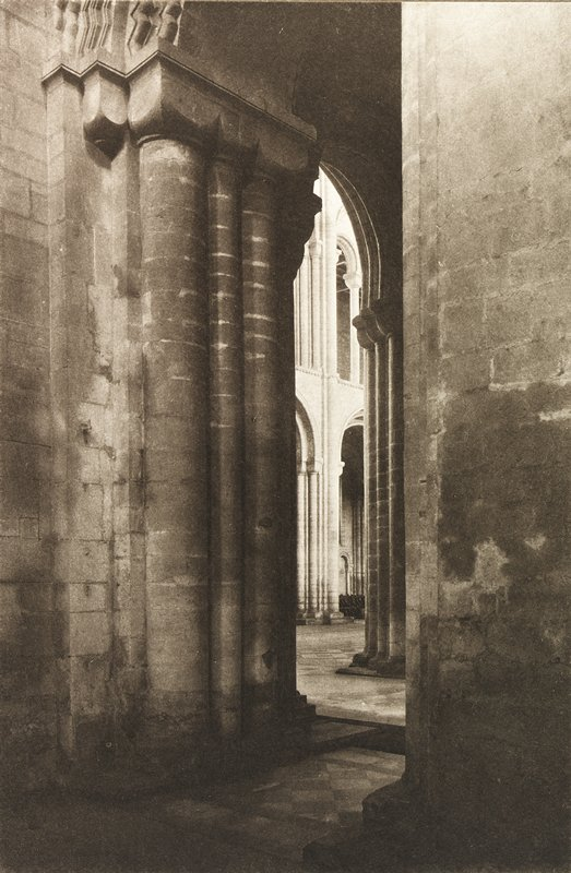 inside view of cathedral columns and large arched doorway