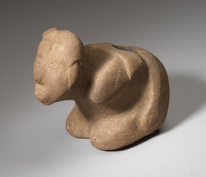 kneeling or crouching figure with arms at sides; face jutting forward; frowning expression; knot on top of head, PR side