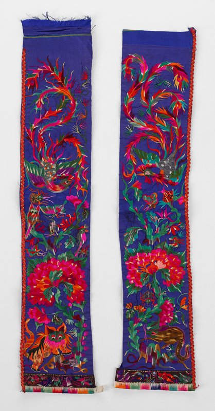 two panels of bright blue satin heavily embroidered with flowers, bird and a tiger on (a) and a rat on (b); bright multi colors; red tape on outer edges with gold metal; horizontal lower borders with frogs, fish and insects