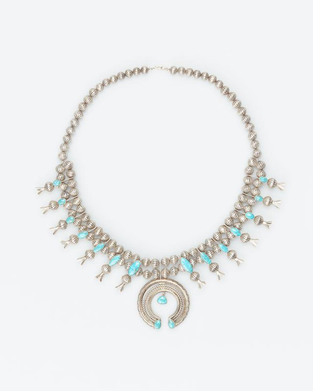 necklace of silver beads; 7 squash blossoms on each side, with single turquoise on each; naja with 3 turquoise