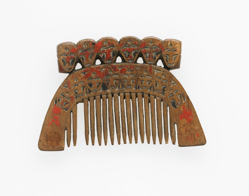 comb topped with six faces (on both sides and on ends) and eight faces above teeth on both sides