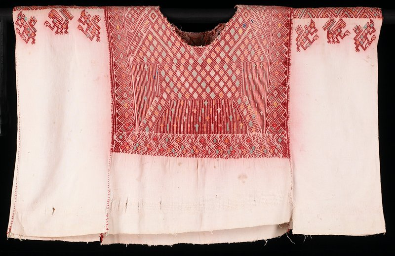 supplementary weft patterning, missing lace collar; warp faced plain weave fabric with weft design with red, blue, yellow (faded); wide contral panel with narrow panels on other sides; same design front and back; narrow panels have shoulder designs (birds)