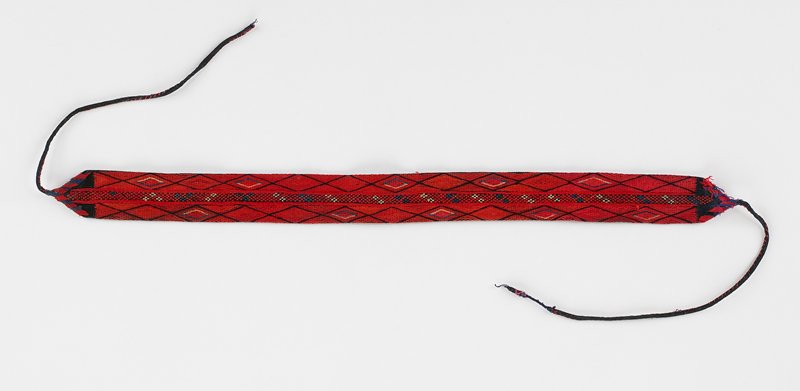 "band with ties at each end has center 1/4"" crosstitch embroidered pattern with 11 diamonds on either side of center; red, blue, white on black; black lining"
