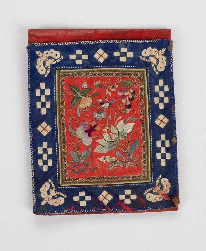 blue and red; blue border with white square design and butterflies surround red rectangle embroidered with bird, flowers, leaves and interior braid; one outside pocket; interior solid red with one inside pocket; machine and hand stitched; single fold; shiny red interior