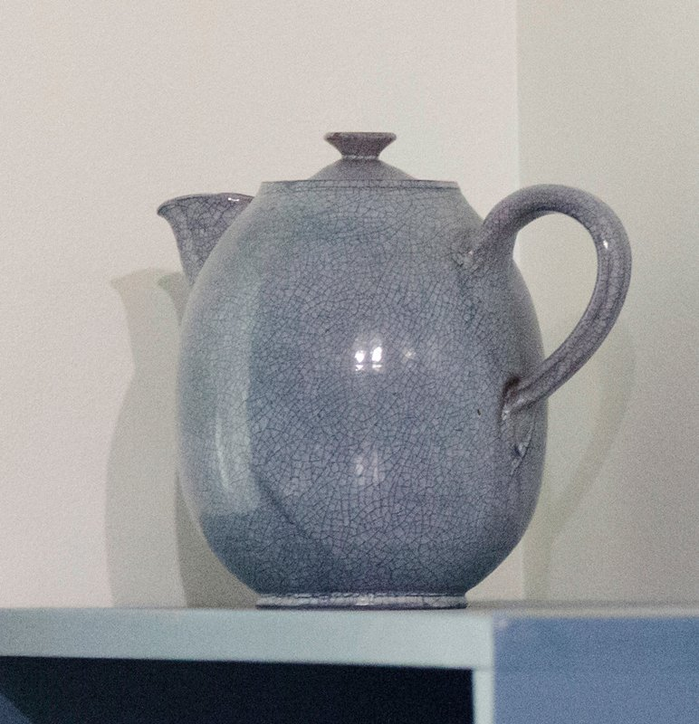 round, bulbous body; light blue glaze with inherant dark blue crackle lines; underside of cover