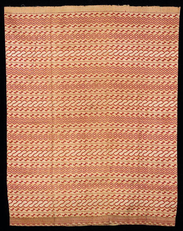 horizontal rows of soft wavy desings in soft red on cream and tan field; center back strip with vertical line only; bottom edge hemmed
