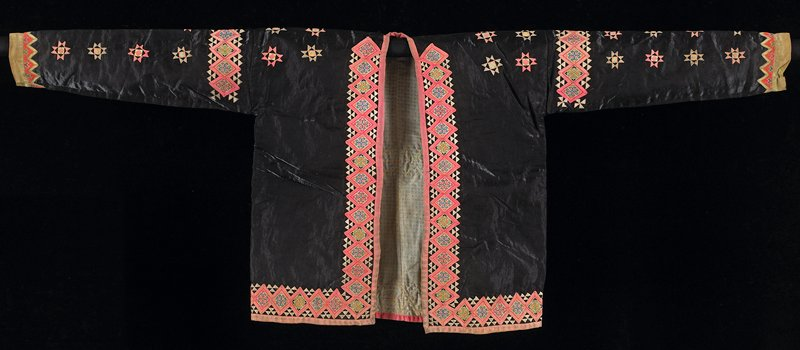 black satin; applique in pink and biege silk with multicolored cross sittch; stripes of diamond shaped decorative elements are at front and low edges, at shoulder and back; yellow silk border at cuffs; printed cotton lining