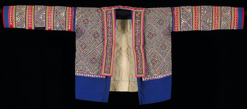 multicolored applique and embroidery throughout body and sleeves; fronts are longer than back with applied embroidered bands on edges; rectangular back collar with applique and cross stitch; lined
