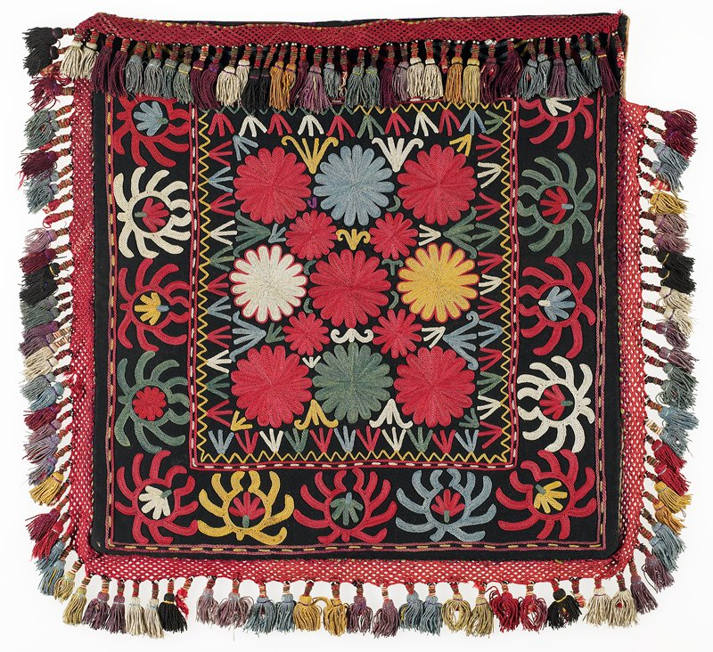 Braided-net fringe, Bag back: striped cloth, lined. Black wool ground with polychrome silk embroidery. There is a braided silk fringe with wrapped tassels of silk, cotton, and metal. The backing is cotton twill, striped in red and white. Center square with borders on all four edges.