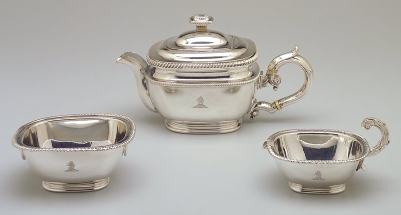 lion on side of teapot, bowl and creamer; screws on each handle; two bands of ivory on large handle