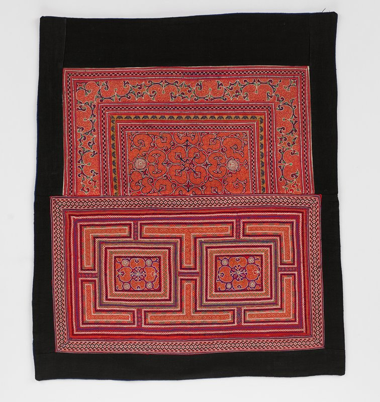 lined in blue; black bordered around fully embroidered red panels in orange, blue, white and green; designs are more Arabic in character