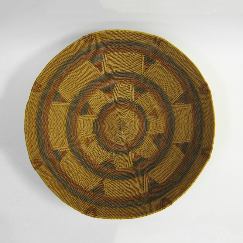Bowl-shaped basket with red and brown design on tan ground; triangles in colored bands