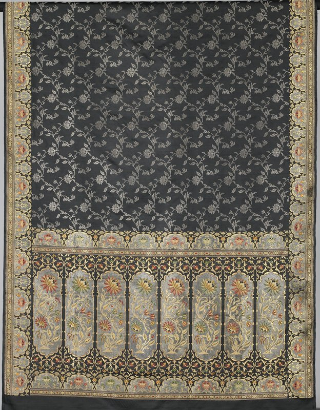 jacquard weave with silk and metallic threads; black; large center field with partial gold borders; center field has repetitive pattern
