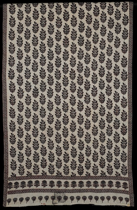 block printed overall in leaf motifs with a narrow border of bird and flower pattern; brown on beige with black lining