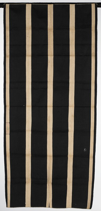 warp face, dark brown with beige stripes running the length; thin lines of color in beige stripes