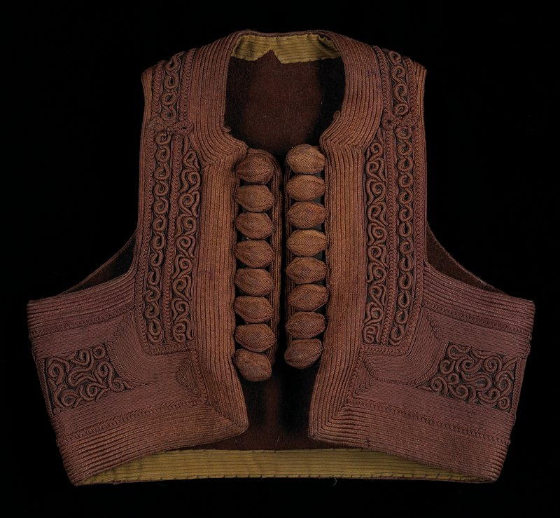 intricately embroidered silk cording with alternate patterns of linear and heavy scroll embroidery; eight large decorative nut shaped buttons on front openings are covered with embroidery; three buttons have coral tips; brown with brown wool (?) felt lining; inside pocket