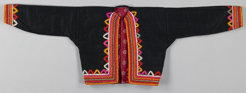 black cotton open front collarless jacket; cuffs and front opening and bottom edge are heavily embroidered in pink, gold, red and white cotton and metallic thread; four black plastic buttons with red loops at bottom; commercial print lining