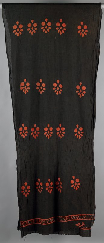 "resist dyed; long with repeat horizontal pattern of five ""flowers"" with border pattern on top and bottom; cotton gauze in dark brown with orange designs"