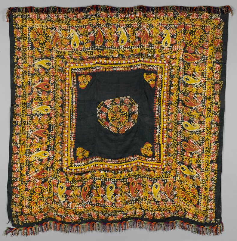 """resist dyed silk square; white, yellow, rust and black; cotton braided 2-1/2"""" fringe on two sides in green, purple, orange, black and white; center black 31"""" square with medallion center; scarf is five sections sewn together"""