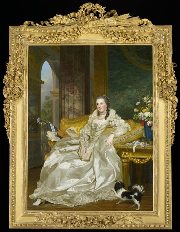 woman wearing a white satin gown trimmed with lace and pearls, holding a book, and seated on a yellow sofa; woman wears pearl necklaces and earrings, with her hair decorated with pearls; guitar and music next to woman on sofa; black and white lap dog in LRC
