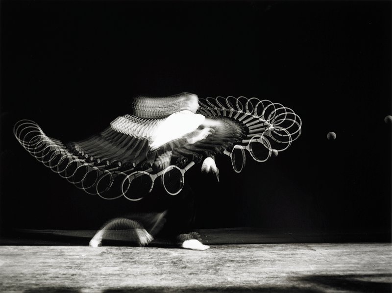 multiple exposure image of a figure hitting a tennis ball