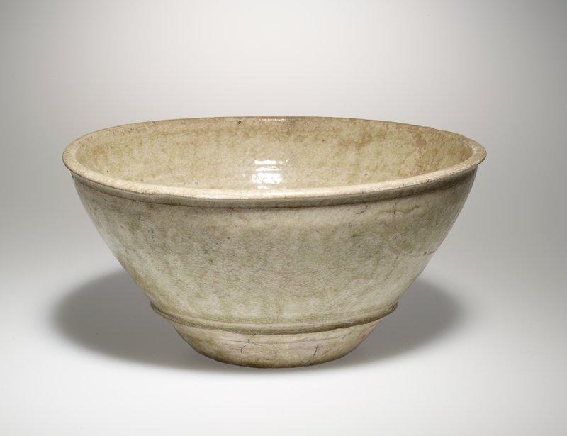 slightly concave bottom; conical interior; green glaze