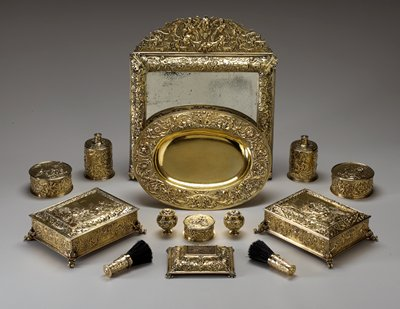 mirror with relief gold frame with foliage and putti; removable top section with fruit, putti and foliage