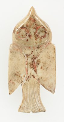 Pendant in bird form (flying bird) seeing from above, in high relief; incised lines to emphasize tail. Opaque ivory jade; traces of red pigment.