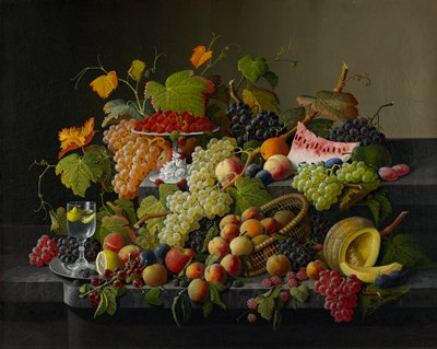 still life with grapes of various colors and grapevines and leaves, melon, peaches, raspberries, blackberries, plums, oranges, apples, lemon; goblet with water with lemon at L; basket at center bottom, white pedestal plate at top left